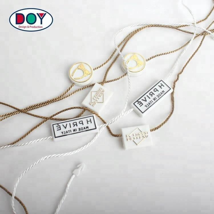 Factory Price Custom Embossed Name LOGO Lock Hang Tag Plastic Seal String for Garment