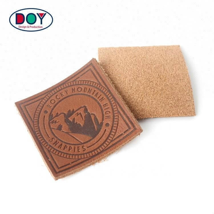 High Quality Hot Stamping Custom Logo Embossed Brown Real Leather logo Labels Patches for Jeans and Bags